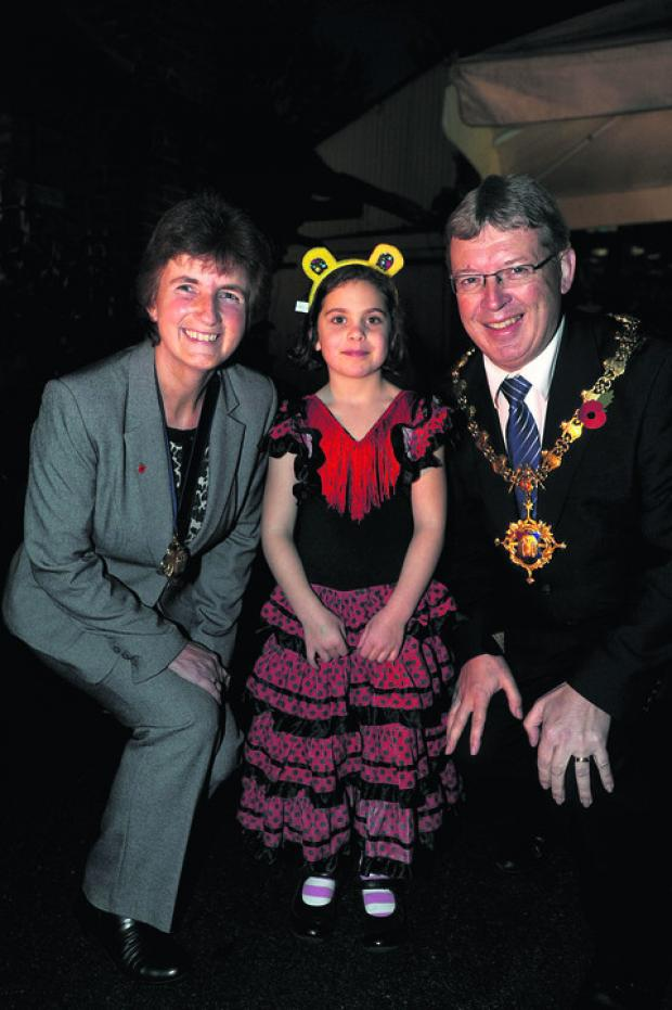 This Is Wiltshire: Seven-year-old Grace Canfield from Devizes with Devizes Mayor and Mayoress Kelvin and Pam Nash