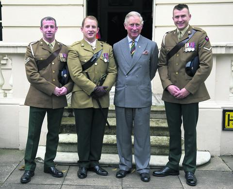 This Is Wiltshire: READY:The Prince of Wales,meets injured Dragoons L/Cpl Nick Webb, Cpl Robert Harmer and Capt Adam Crookshank.