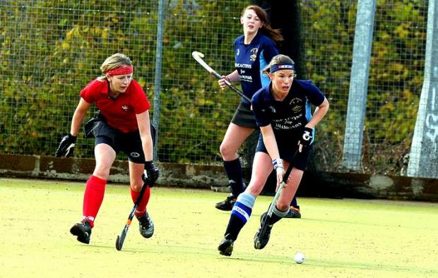 This Is Wiltshire: Wootton Bassett's Suzanne Coles, right, in action against BAC