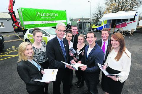 Ed McKeever meets some of Hitachi's new apprentices including Victoria Banks, Issie Breach, Gemma Crook, James Barker, Jenny Goff and Bethany Starns. In the foreground is managing director Jon Lawes and chief executive Simon Oliphant with Olympic champi