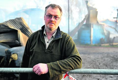 This Is Wiltshire: Farmer Adrian Leighfield in front of the gutted barn at Grove Farm in Grittenham. 		   PICTURE BY james douglas