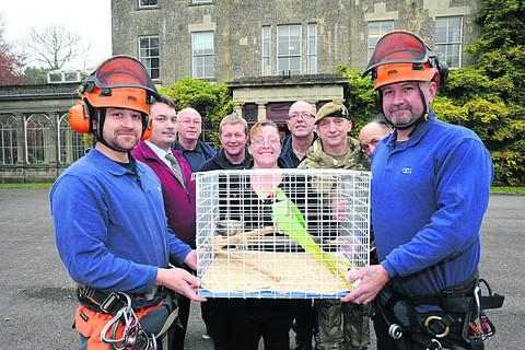 This Is Wiltshire: Tree surgeons Jim Tyson and John Limbrick, owner Pauline Penny and Gromit, site manager Mike Wakelin, (back) Bill Biles, Rob Rogers, Paul Raymond, Colour Sergeant Charlie Lawrence and Nigel Stokes