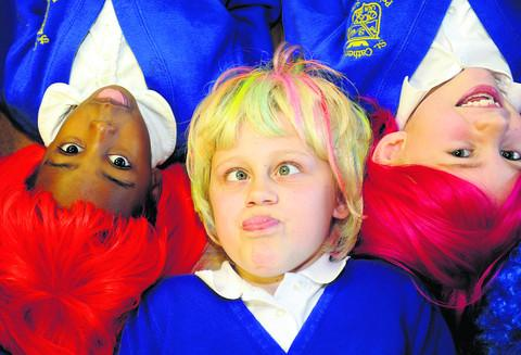 This Is Wiltshire: Phoebe Maddison, centre, with fellow pupils in their wigs