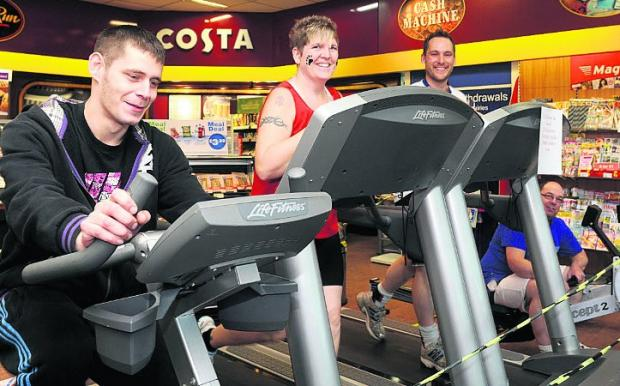 This Is Wiltshire: TRIPLE challenge  Esso staff, from left, Tomm Ward, Karen Rose, Dan Robson and Andy Bushnell stepping up for their 24-hour gym marathon session Picture: Siobhan Boyle