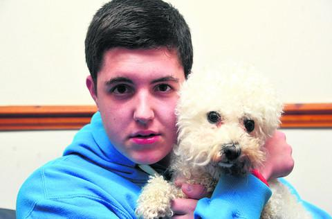 This Is Wiltshire: Sam Poynter with his dog Snowy, who was attacked by a rottweiller