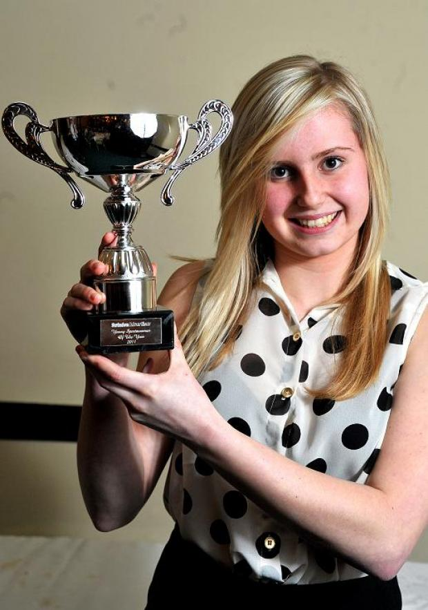 This Is Wiltshire: Georgia Clements with the Swindon Advertiser Young Sportswoman of the Year 2011 trophy