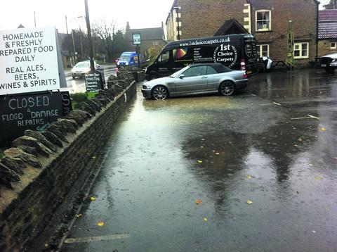 This Is Wiltshire: Flooding at the Radnor Arms yesterday