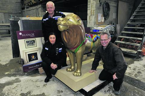 This Is Wiltshire: PC Hazel Anderson and PCSO Shaun Redmond of the Corsham Neighbourhood Policing Team check on the restoration of the Corsham lion with Paul Baker, managing  director of Rudloe Stone