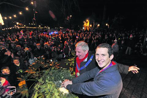 This Is Wiltshire: Olympic gold medallist Ed McKeever switches on the lights with mayor John Potter