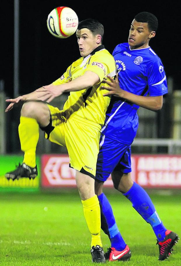 This Is Wiltshire: Chippenham Town's Tyrone Mings challenges AFC Totton's Richard Gillespie (Picture by Robin Foster)