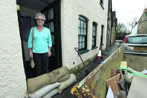 This Is Wiltshire: Patricia Pouting at the front door to her flooded home