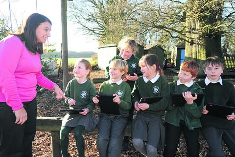 This Is Wiltshire: St Katharine's headteacher Sharon Cross with pupils using their iPad tablets