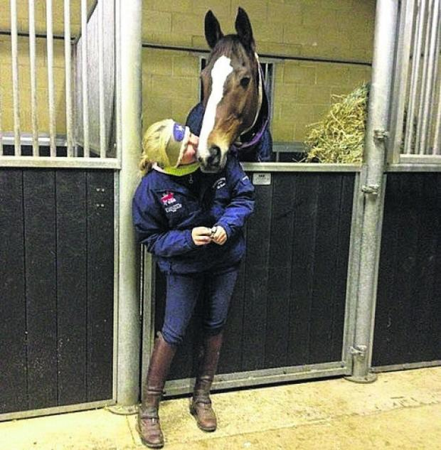 This Is Wiltshire: Laura Collett posted a picture of herself on Twitter greeting legendary racehorse Kauto Star after his arrival at her Membury Estate base on Tuesday
