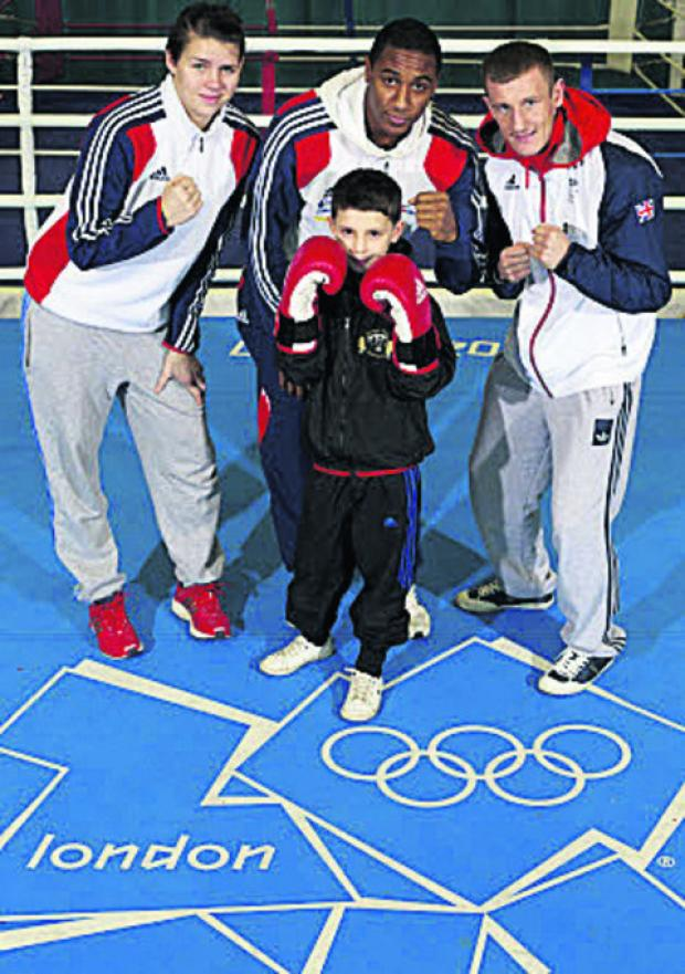This Is Wiltshire: Jack Ball, of Devizes Amateur Boxing Club, pictured with Team GB boxers past and