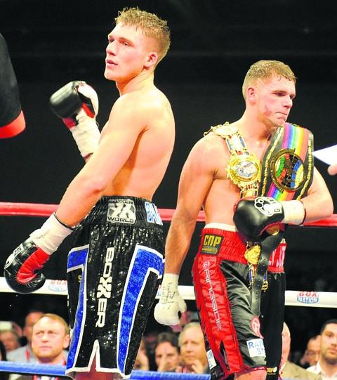 Nick Blackwell takes the applause from the ExCel crowd while Billy Joe Saunders gets to grips with his titles