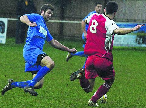 Calne's Kris Beasley (blue) and Corsham's Nick Holton compete for possession shortly before yesterday's match at Bremhill View was abandoned