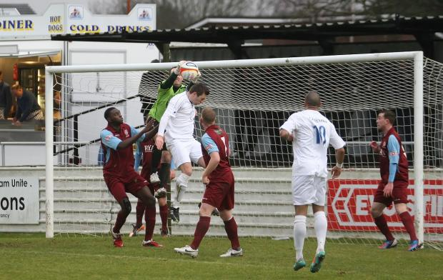 This Is Wiltshire: Chippenham's Steve Casey challenges in the Chesham penalty area (Picture by Robin Foster)