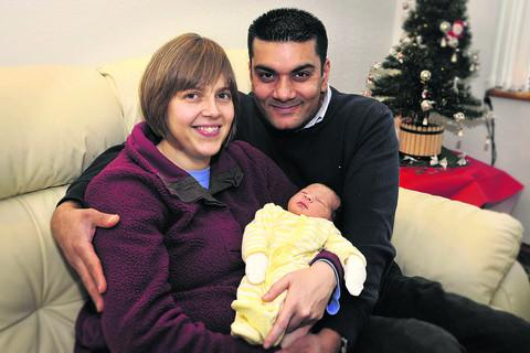 This Is Wiltshire: Christmas Day baby Eden Chudasama with parents Shailan and Lisa Chudasama