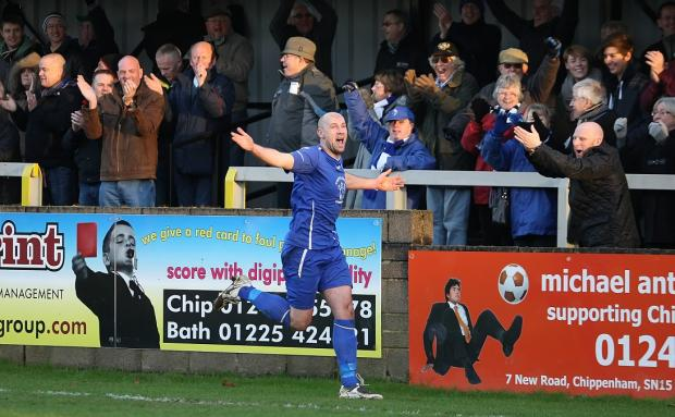 This Is Wiltshire: Chippenham Town's Alan Griffin celebrates after putting his side 2-0 up on New Year's Day (Picture by Robin Foster)