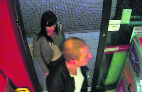 This Is Wiltshire: The couple enter the Total garage in Semington Road, Melksham