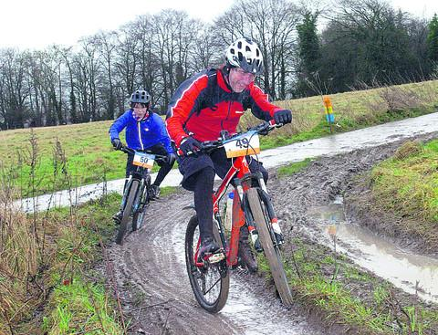 This Is Wiltshire: Riders battle with the muddy conditions on the ride on Sunday