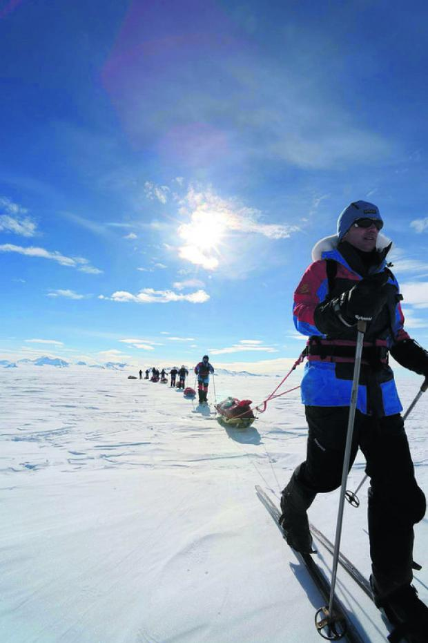 This Is Wiltshire: Captain Adam Crookshank and other injured soldiers making their way across the South Pole