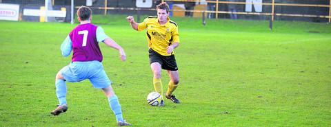 This Is Wiltshire: Melksham's Luke Smith goes on the attack during Tuesday's home defeat Photo: Diane Vose