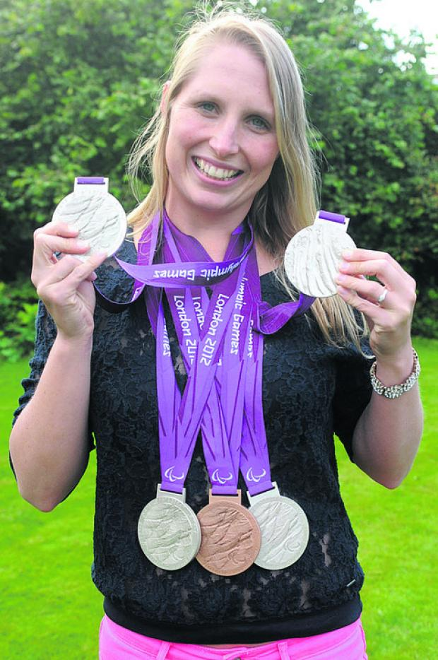 This Is Wiltshire: Stephanie shows off the spoils gained from the London 2012 Paralympic Games this summer