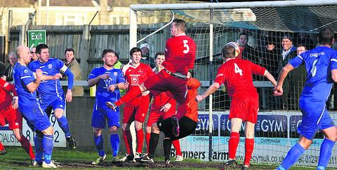This Is Wiltshire: Frome's Ryan Bennett (4) heads into his own net for Chippenham's opener during Tuesday's 2-2 draw (Picture by Robin Foster)