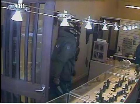 This Is Wiltshire: Robber Christopher Pike, wearing a motorcyle helmet and leathers, is caught on CCTV entering County Jewellers