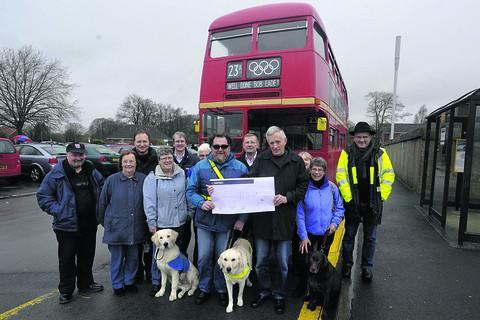 Bus event aids guide dog group