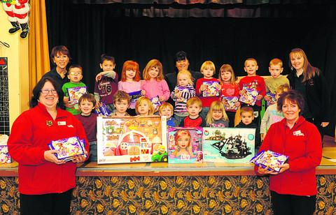 Kay Webb and Wanda Miluk of Wilkinson present toys and selection boxes to St Michael's Pre-School in Hilperton