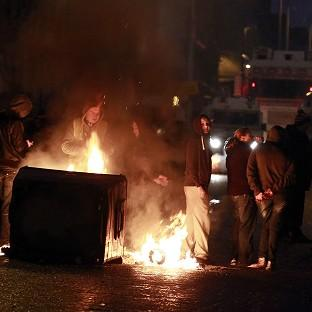 This Is Wiltshire: A burning barricade on the Newtownards road area of Belfast, where police were targeted by rioters