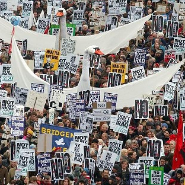 This Is Wiltshire: Anti-war demonstrators making their way down Piccadilly in central London in 2003