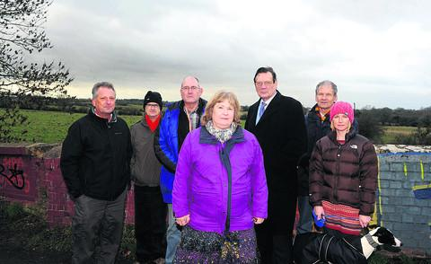 This Is Wiltshire: Residents and councillors are unhappy at plans for homes on Ridgeway Farm. From left, Kevin Fisher, Martyn Parrott, Nick Fisher, Jacqui Lay, Garry Perkins, Roger Ogle and Paula Russell with Otis