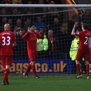This Is Wiltshire: Luis Suarez, centre, celebrates scoring Liverpool's controversial second goal