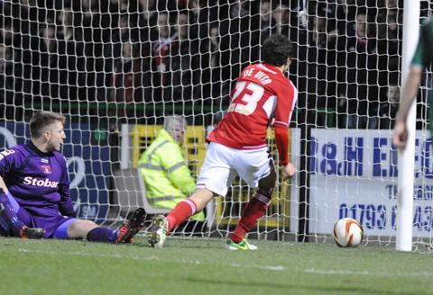 Raffa De Vita scores his goal for Swindon Town during their 4-0 win against Carlisle United