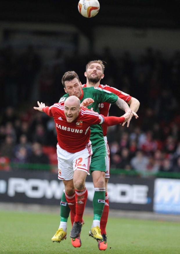 This Is Wiltshire: Swindon Town's Darren Ward and Alan McCormack combine to win a header