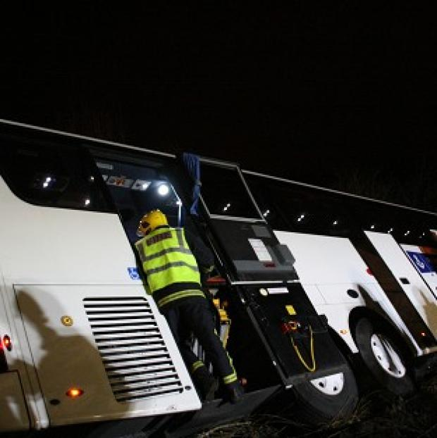 This Is Wiltshire: A coach carrying 26 passengers overturned while travelling on on the M3 southbound a mile from Fleet services