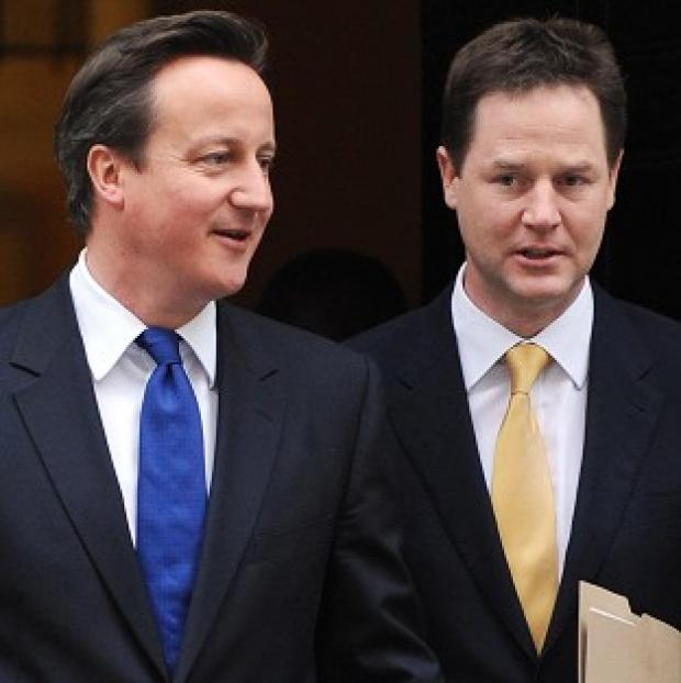 This Is Wiltshire: David Cameron and Nick Clegg say their coalition government is 'steadfast and united'