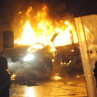 This Is Wiltshire: A burned out car during disturbances which erupted in east Belfast