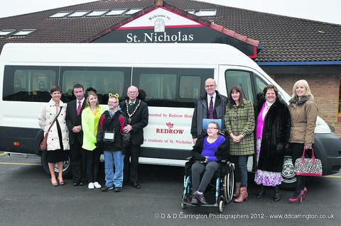 This Is Wiltshire: The new minibus is handed over to staff and pupils of St Nicholas School