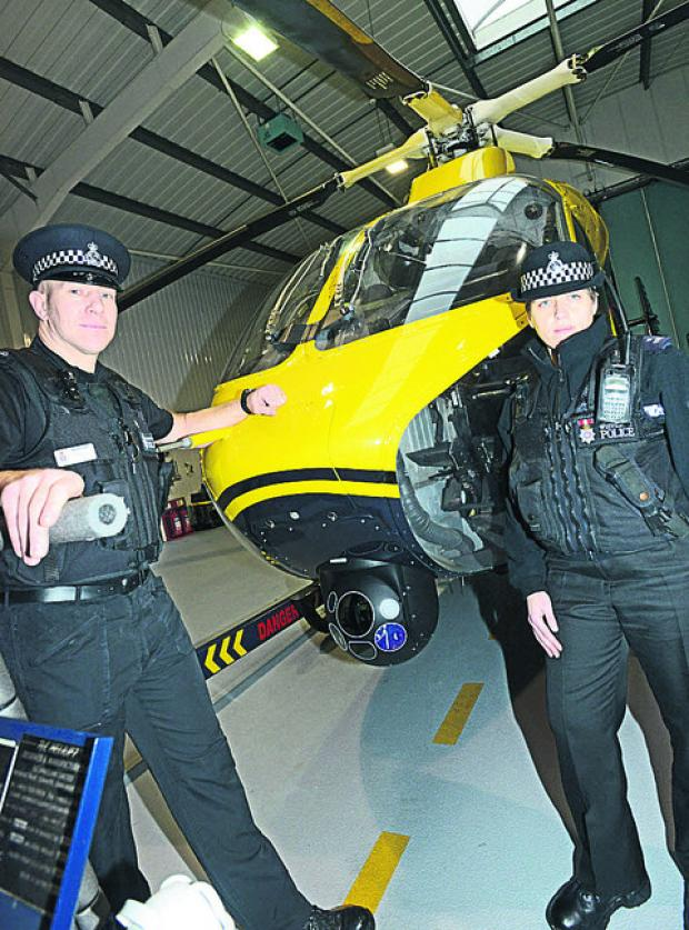 This Is Wiltshire: PC Pete Lawson and Emma Reed with the police helicopter