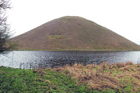 This Is Wiltshire: So much rain has fallen that Silbury Hill now looks like it is surrounded by a moat