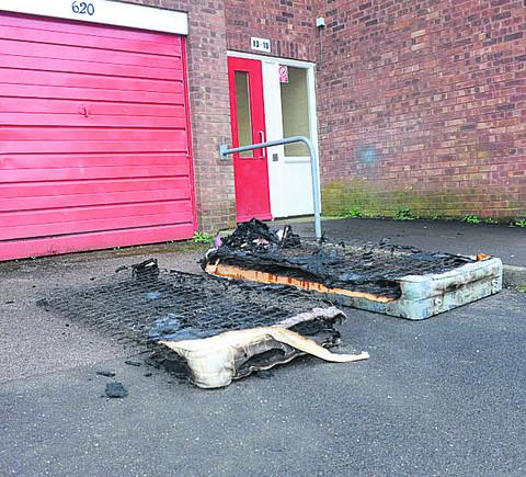 The charred remains of the bedding outside the flat