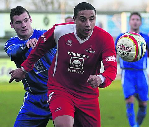 This Is Wiltshire: Aaron Ledgister, pictured playing against Chippenham Town on New Year's Day