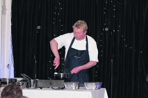 This Is Wiltshire: Lee Bamforth demonstrates his skills to members of the Malmesbury Cake Society