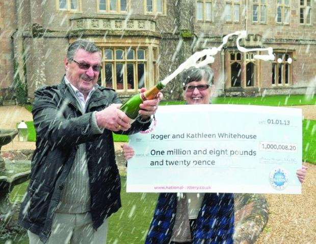 This Is Wiltshire: Champagne celebration for Roger and Kath Whitehouse, who were visiting family here when they bought their lucky ticket