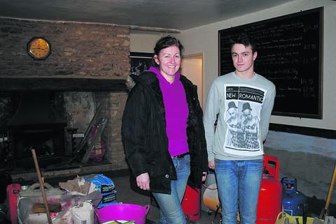 Paula Webley and her son Connor as they prepare to reopen the Radnor Arms after flooding