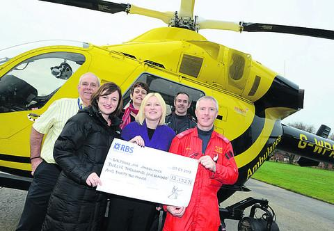 This Is Wiltshire: From left, The Consortium's Paul Ford, Louise Sparke, Jo Trigg and Holly Jeal with Rob Backus and Steve Riddle from Wiltshire Air Ambulance